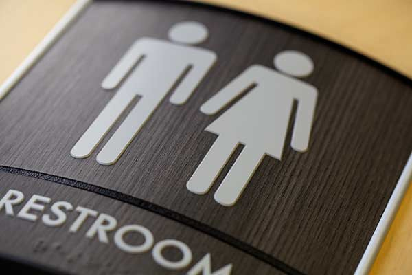 Bathroom Signs And Pictures curved wood bathroom ada signs | curved modular sign systems madera