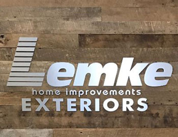 Dimensional Brushed Metal Letters on Reclaimed Wood