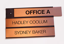 Interchangeable Stacking Signs for Doors